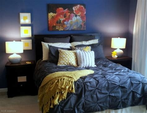 navy and yellow bedroom with white comforter instead of